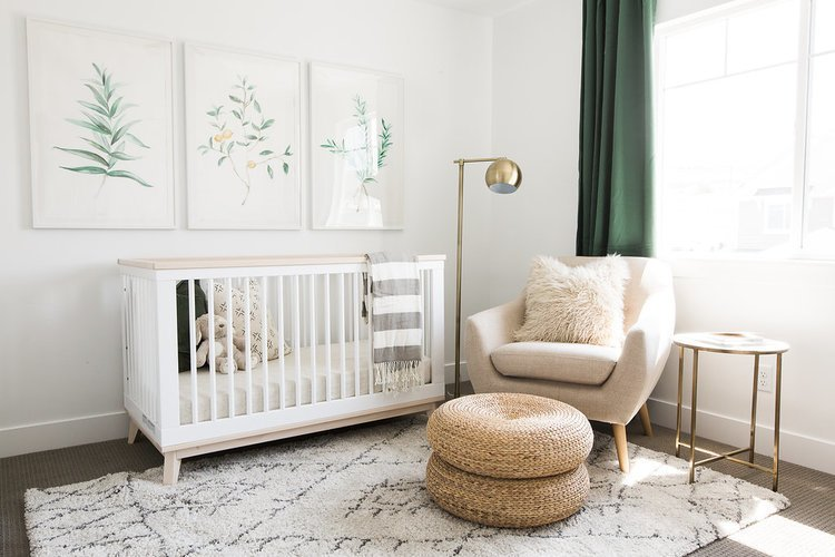 The nursery of the Ironhorse Resident by Akin Design Studio provides clean earth tones and various textures. The nursery ties in the hushed palette from the rest of the home.  The aesthetic is soft, but mature and establishes a modern style a child can never easily outgrow.