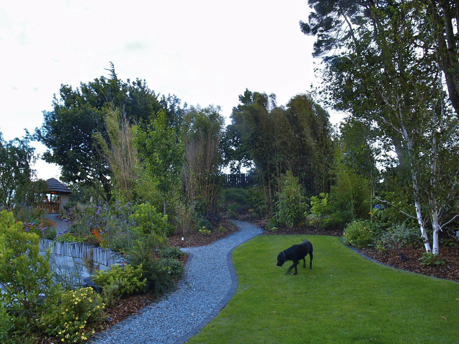 One of the gardens several granite sett-edged lawns.  Except for the oak at the back, all planting in shpt is new.  Clifftop garden North Wales by Scott Fairley