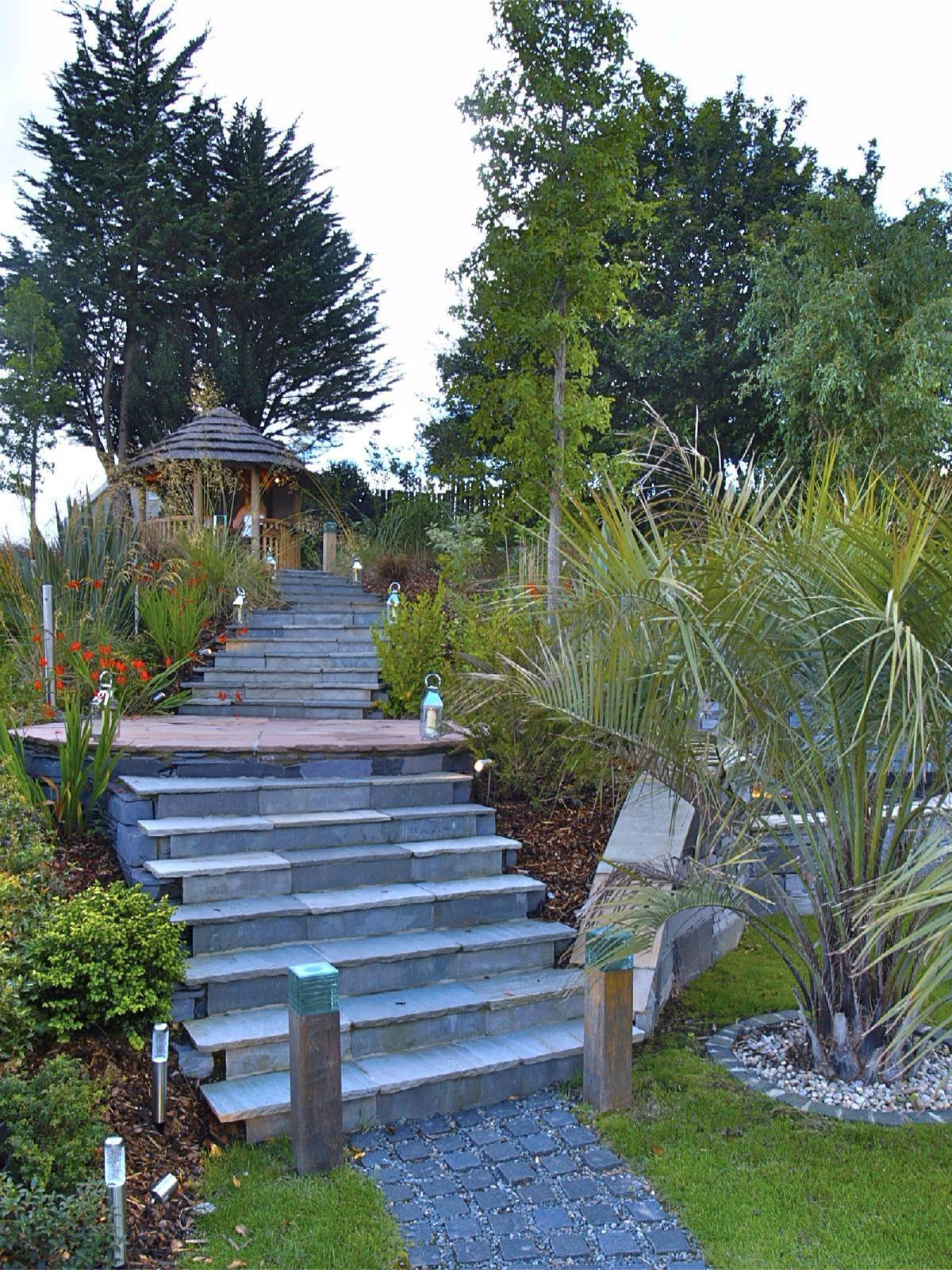 Steps were clad in riven sandstone for a rustic, soft finish, but provided a difficult material to work with due to very broad sizes and thicknesses supplied.  Clifftop garden North Wales by Scott Fairley