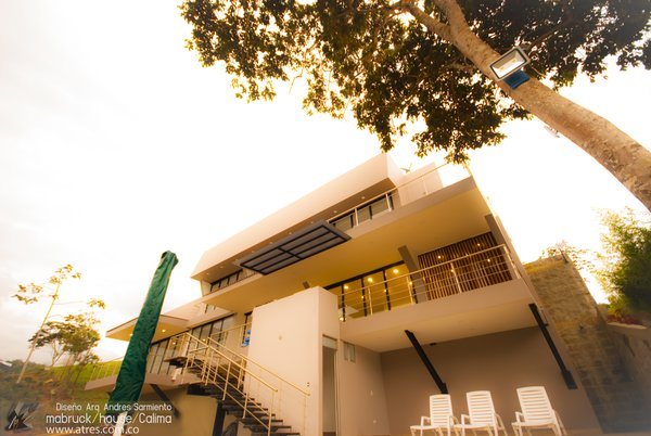 Modern home with back yard, trees, small pool, and outdoor. Photo 2 of Mabruck House- Calima