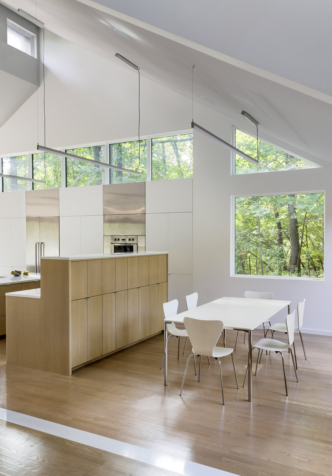 Tagged: Dining Room, Table, Chair, and Light Hardwood Floor.  3LP Residence by Substance Architecture