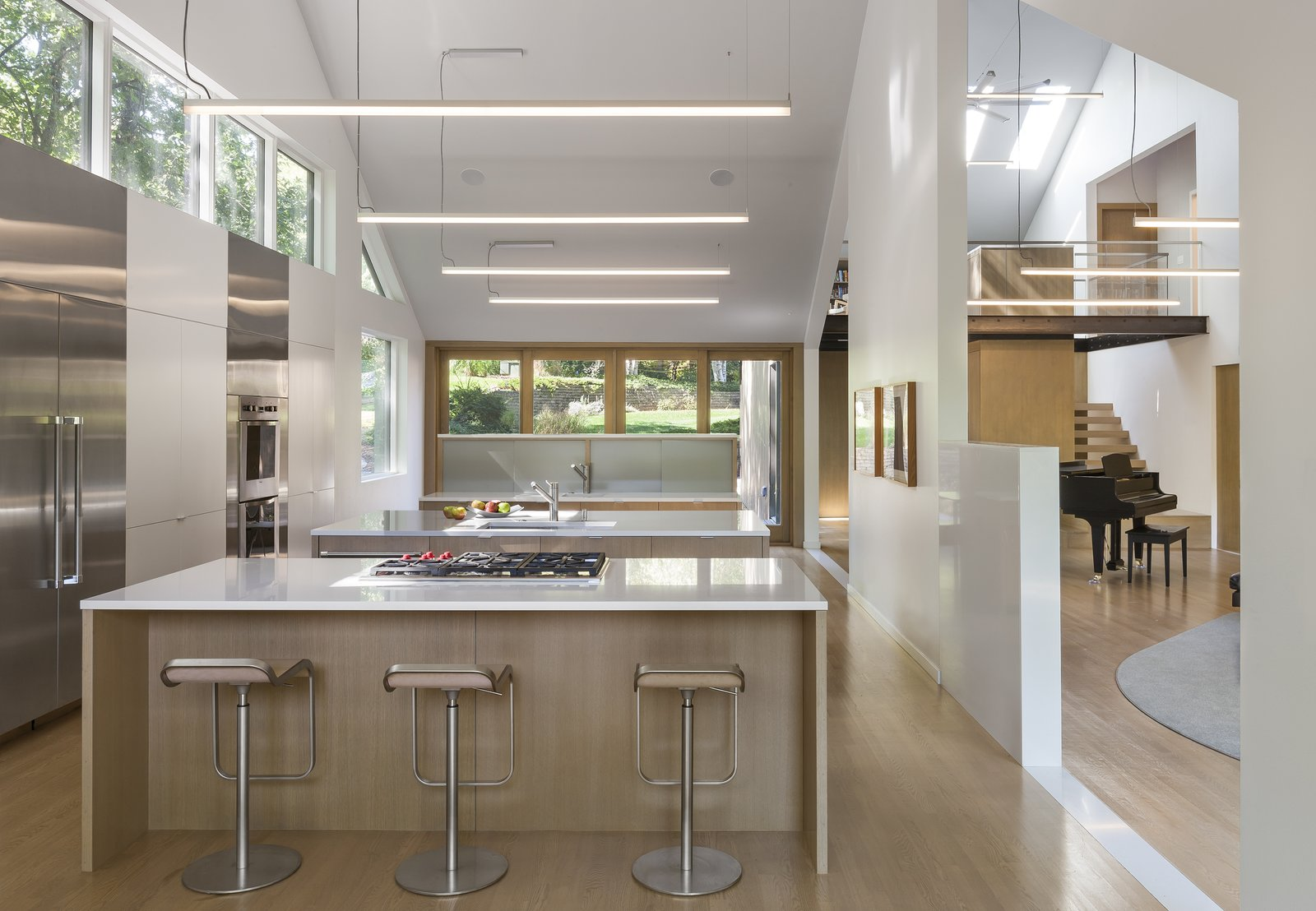 Tagged: Kitchen, Light Hardwood Floor, White Cabinet, and Refrigerator.  3LP Residence by Substance Architecture