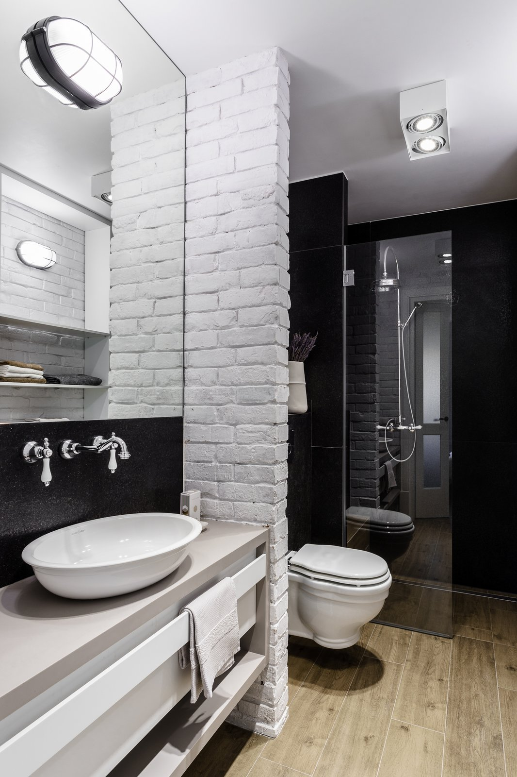 Tagged: Bath Room, Engineered Quartz Counter, Light Hardwood Floor, Vessel Sink, Corner Shower, Ceiling Lighting, Wall Lighting, Enclosed Shower, and One Piece Toilet.  Loft in Poland by Lucyna Kołodziejska | INTERIORS FACTORY