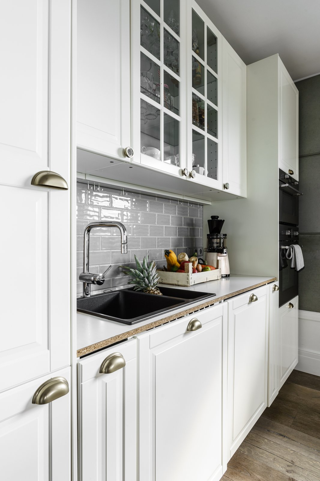 Tagged: Kitchen, Subway Tile Backsplashe, Glass Tile Backsplashe, White Cabinet, and Drop In Sink. Loft in Poland by Lucyna Kołodziejska | INTERIORS FACTORY