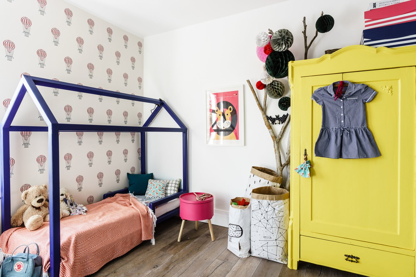 Tagged: Kids Room, Bedroom, Playroom, Bed, Light Hardwood Floor, Pre-Teen Age, Toddler Age, Dresser, and Neutral Gender.  Loft in Poland by Lucyna Kołodziejska | INTERIORS FACTORY