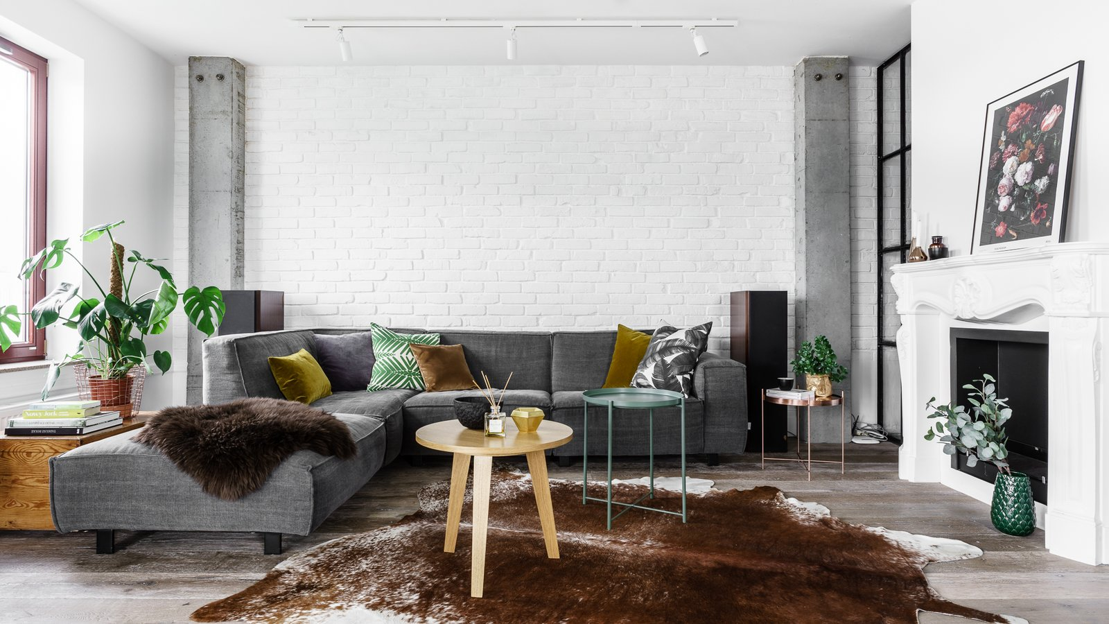 Tagged: Living Room, Sectional, Track Lighting, Medium Hardwood Floor, and Standard Layout Fireplace.  Loft in Poland by Lucyna Kołodziejska | INTERIORS FACTORY