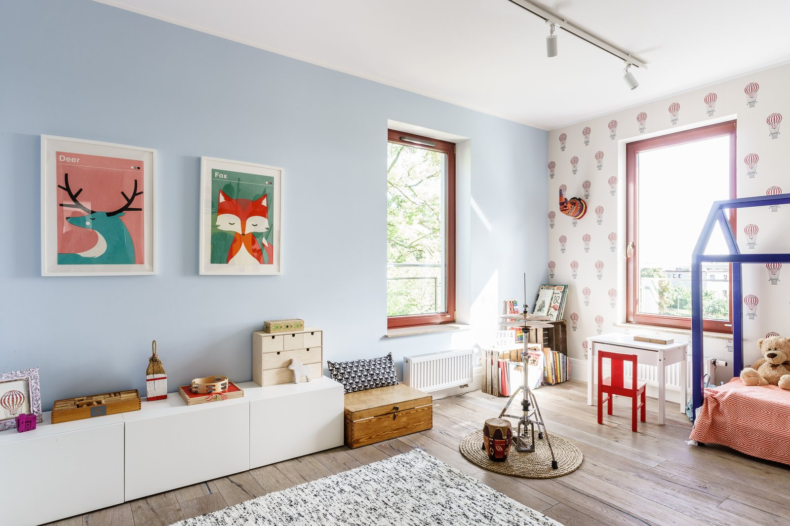 Tagged: Kids Room, Playroom, Bed, Storage, Bedroom, Toddler Age, Light Hardwood Floor, Neutral Gender, and Pre-Teen Age.  Loft in Poland by Lucyna Kołodziejska   INTERIORS FACTORY