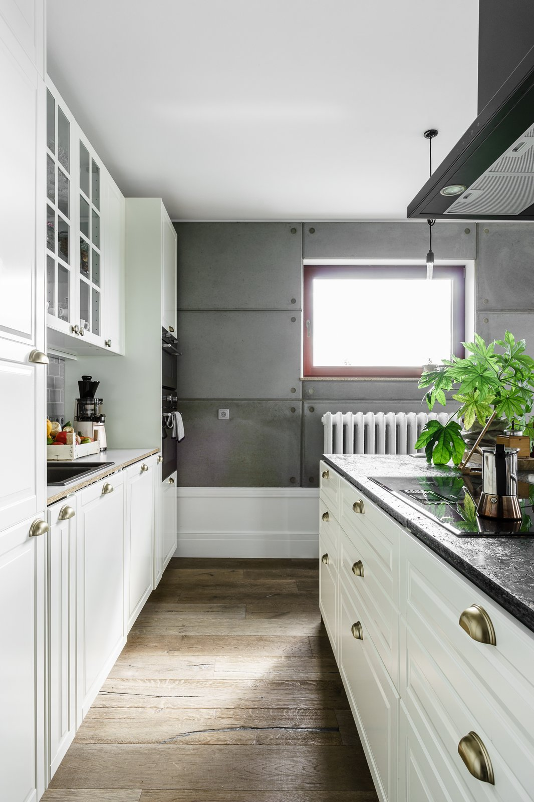 Tagged: Kitchen, Cooktops, White Cabinet, Granite Counter, Medium Hardwood Floor, Range Hood, and Drop In Sink.  Loft in Poland by Lucyna Kołodziejska | INTERIORS FACTORY