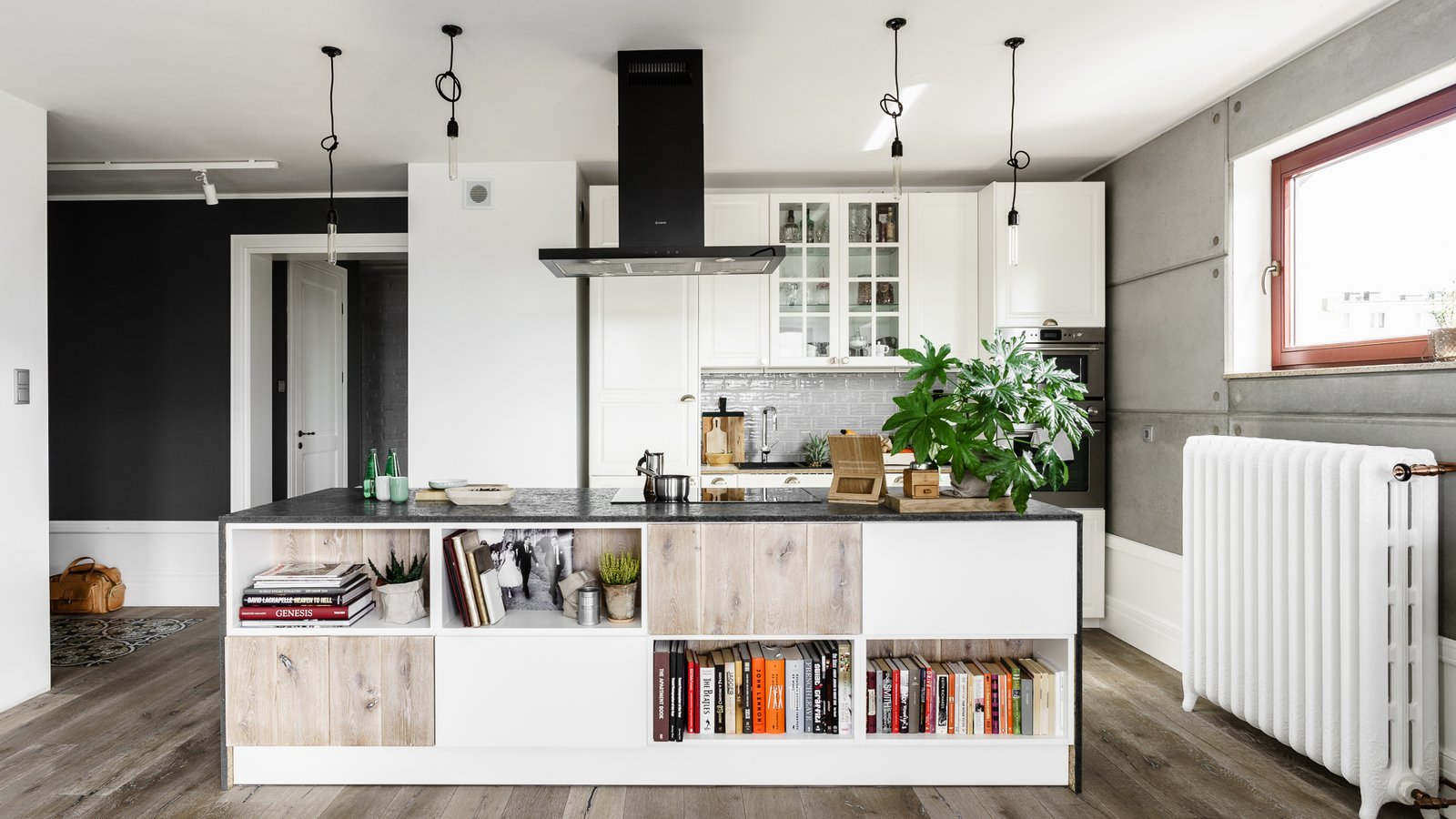 Tagged: Kitchen, Medium Hardwood Floor, Granite Counter, Glass Tile Backsplashe, White Cabinet, Cooktops, Pendant Lighting, Range Hood, and Subway Tile Backsplashe.  Loft in Poland by Lucyna Kołodziejska | INTERIORS FACTORY