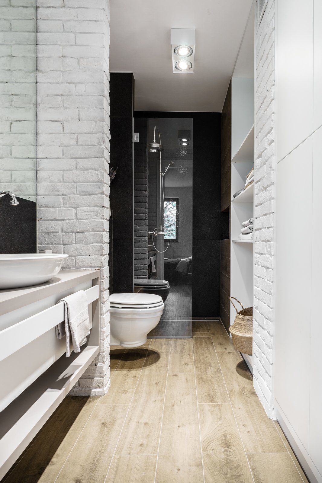 Tagged: Bath Room, Corner Shower, Light Hardwood Floor, Vessel Sink, Engineered Quartz Counter, Enclosed Shower, Ceiling Lighting, and One Piece Toilet.  Loft in Poland