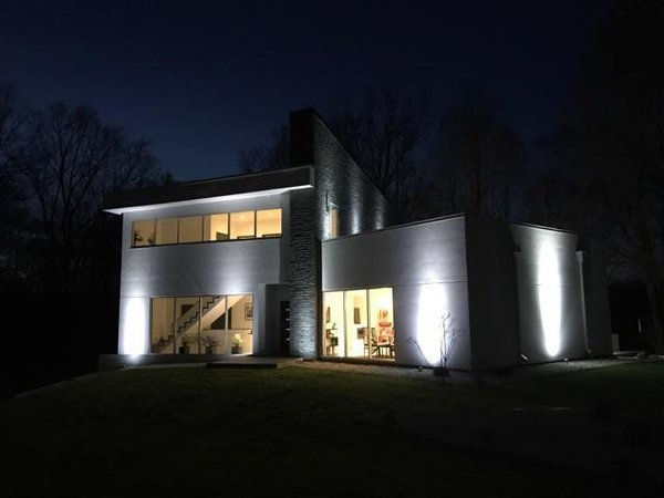 Modern home with outdoor, front yard, and landscape lighting. At twilight. Photo 3 of The Maher House