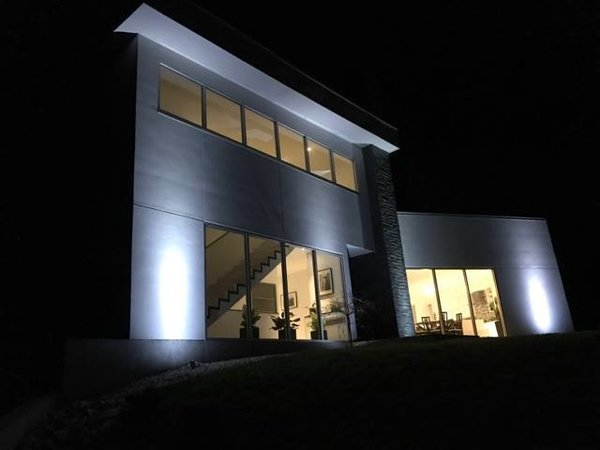Modern home with outdoor, front yard, and landscape lighting. Front Photo 4 of The Maher House