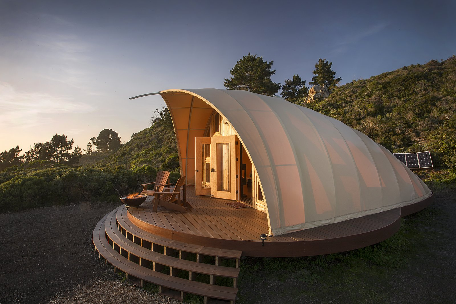 The Autonomous Tent - It's kind of like a yurt, only the high tech manufacturing process ensures absolute precision providing simple installation and a tight seal between fabric and frame that cannot be accomplished with a yurt, making the structure look and feel more permanent.   Cabins & Hideouts by Stephen Blake from The Autonomous Tent at Treebones Resort