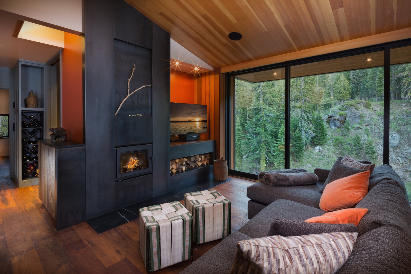 Family Room Tagged: Living Room, Standard Layout Fireplace, Medium Hardwood Floor, Recessed Lighting, and Sofa.  New Tahoe by Studio Bergtraun Architects