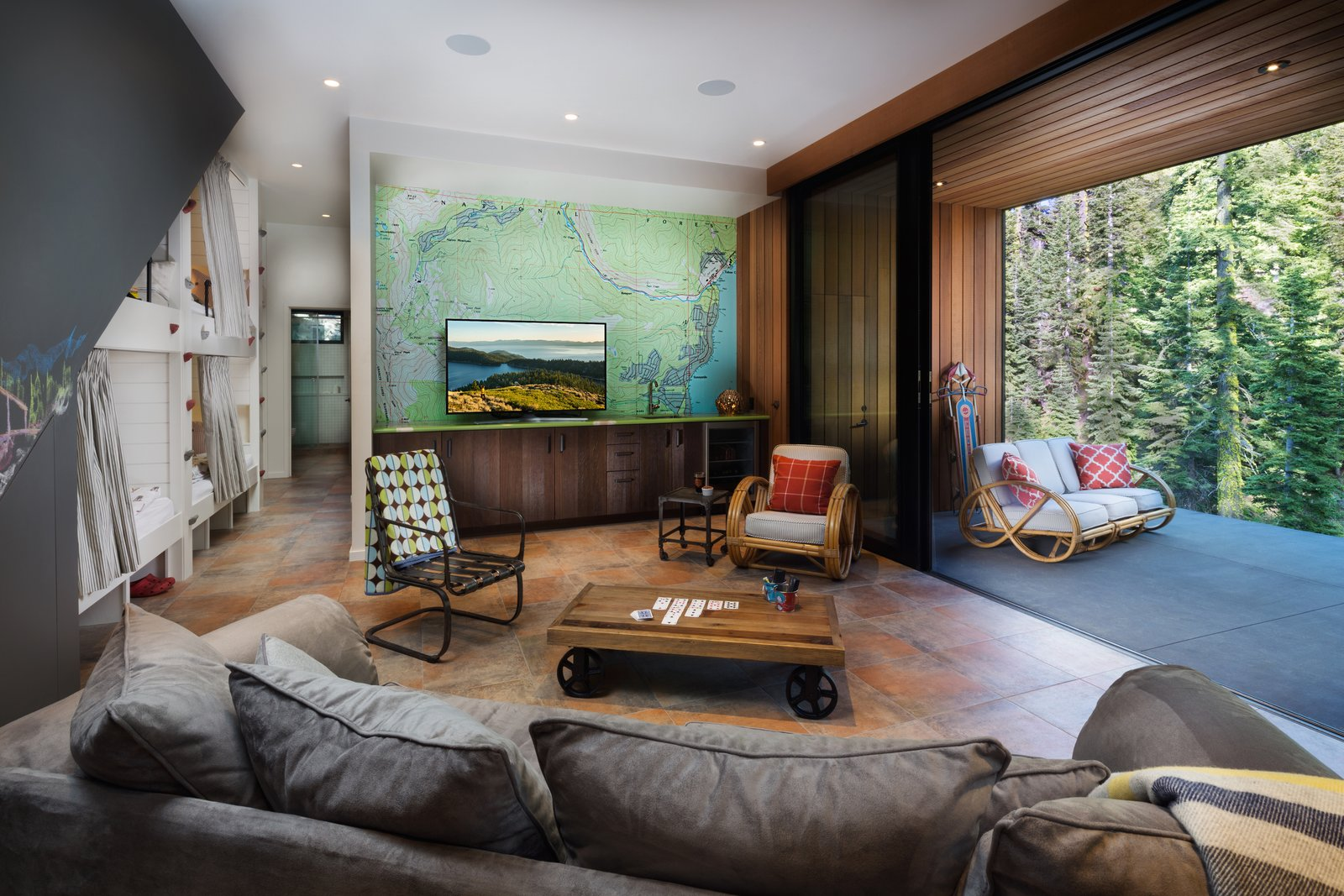 Den with indoor/outdoor patio and Tahoe map  New Tahoe by Studio Bergtraun Architects