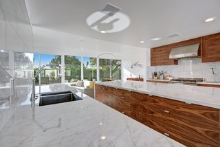 Donald Wexler Himself Helped Renovate This Palm Springs Prefab Rental - Photo 3 of 8 - To keep the home as open as possible, elements like refrigerator drawers were selected in lieu of traditional appliances.