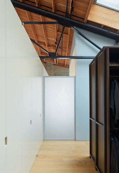In the back right, you'll see that one of only two rooms touch the shell of the home. Fiedler Marciano Architecture kept the ceiling open and airy, respecting the integrity of the original architecture of the loft.