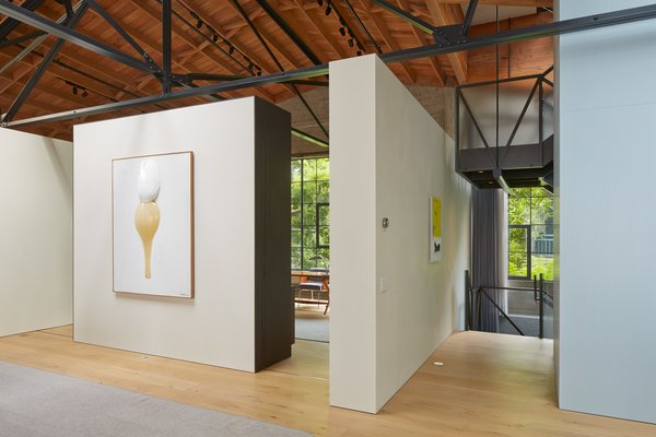 "Free-standing walls highlight the couple's noteworthy art collection. ""The owner has a phenomenal eye,"" says architect Martin Marciano. ""She could be curating in any modern art museum."""