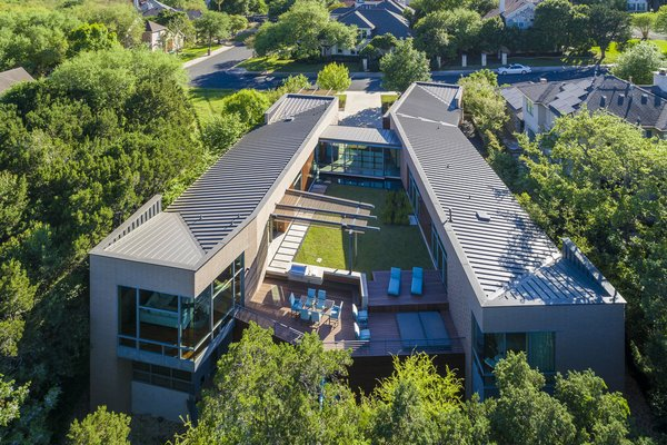 South-facing roof (20 degree pitch) pre-wired for 15 kW photovoltaic panel system, projected to reduce annual energy bill by approximately 85% Photo  of Scout Island Residence - A Masterpiece by alterstudio modern home
