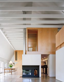 12 Modern Marvels in New England - Photo 9 of 12 - Simple and durable, yet elegant materials such as polished concrete, second-grade oak flooring, and maple plywood are used throughout. Interior and exterior connect visually through a wall of glass doors to the garden and fields beyond.