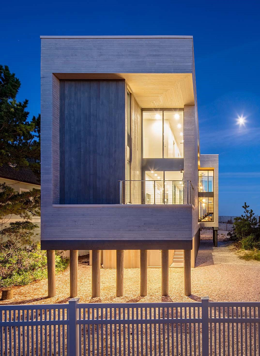 Beach Haven Residence, Exterior at Twilight.   Beach Haven Residence by Specht Architects