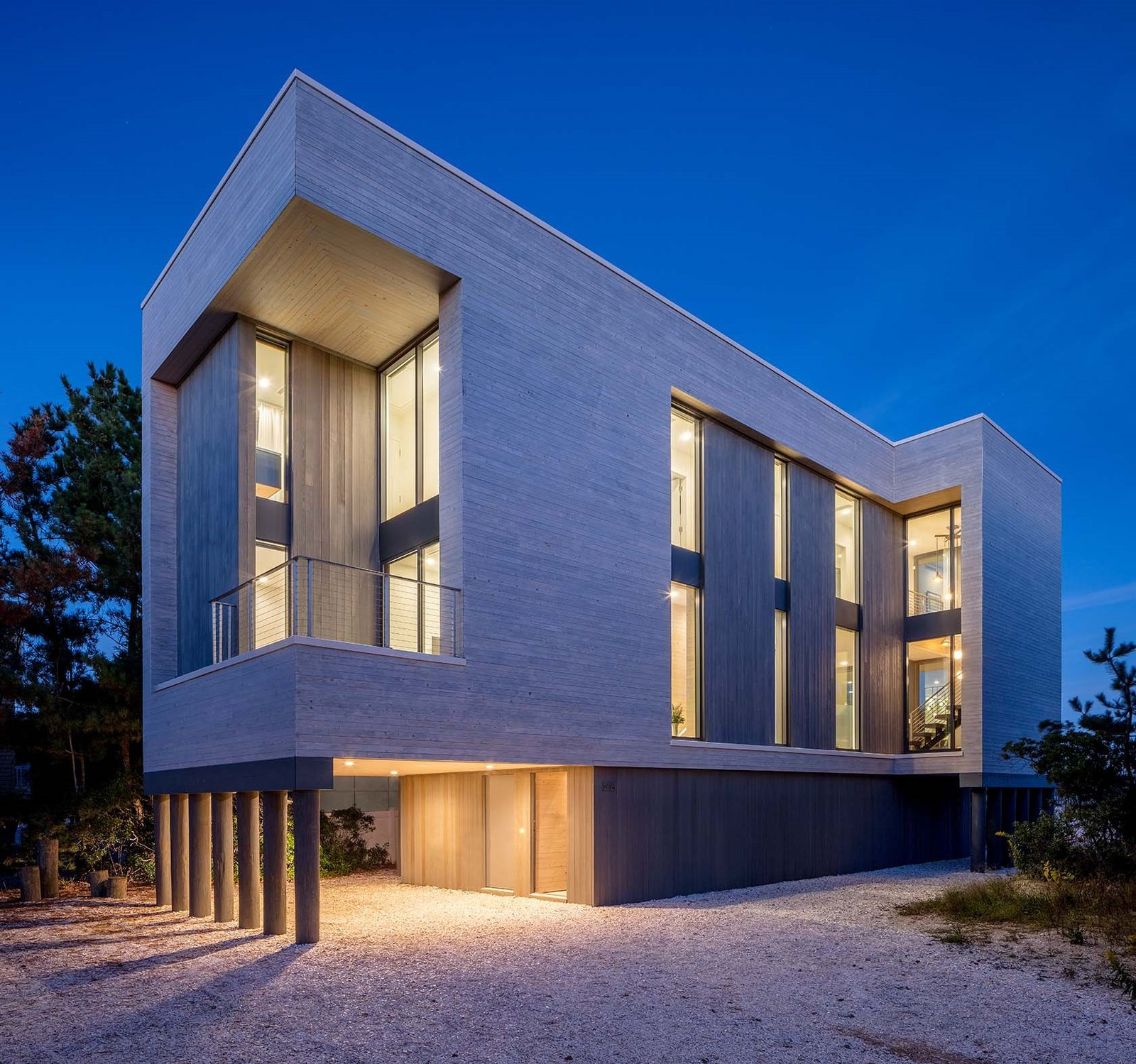 Beach Haven Residence, Full Exterior at Twilight.