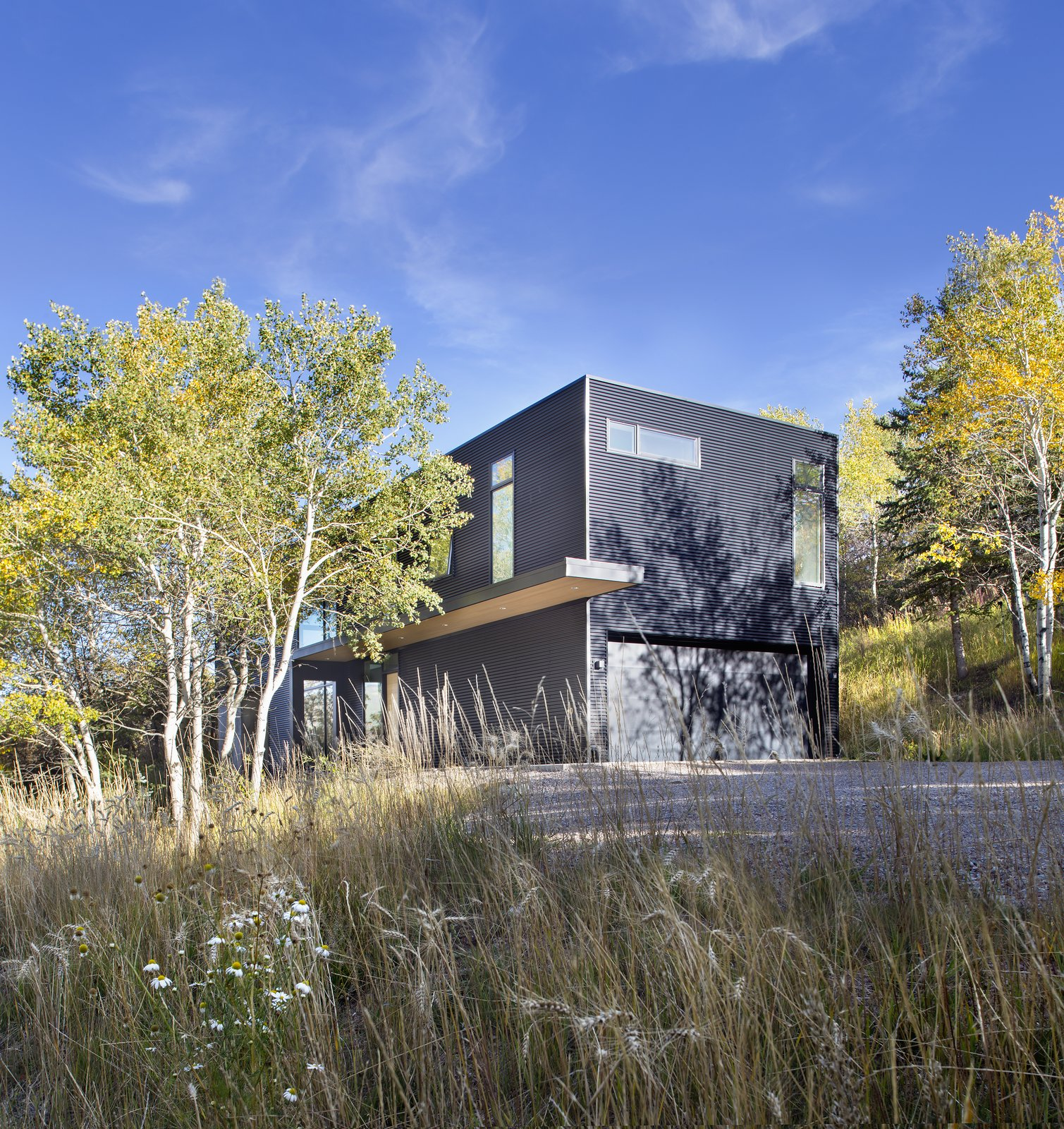 Tagged: Exterior, Cabin Building Type, Concrete Siding Material, and Metal Siding Material.  Black Magic by rowland + broughton