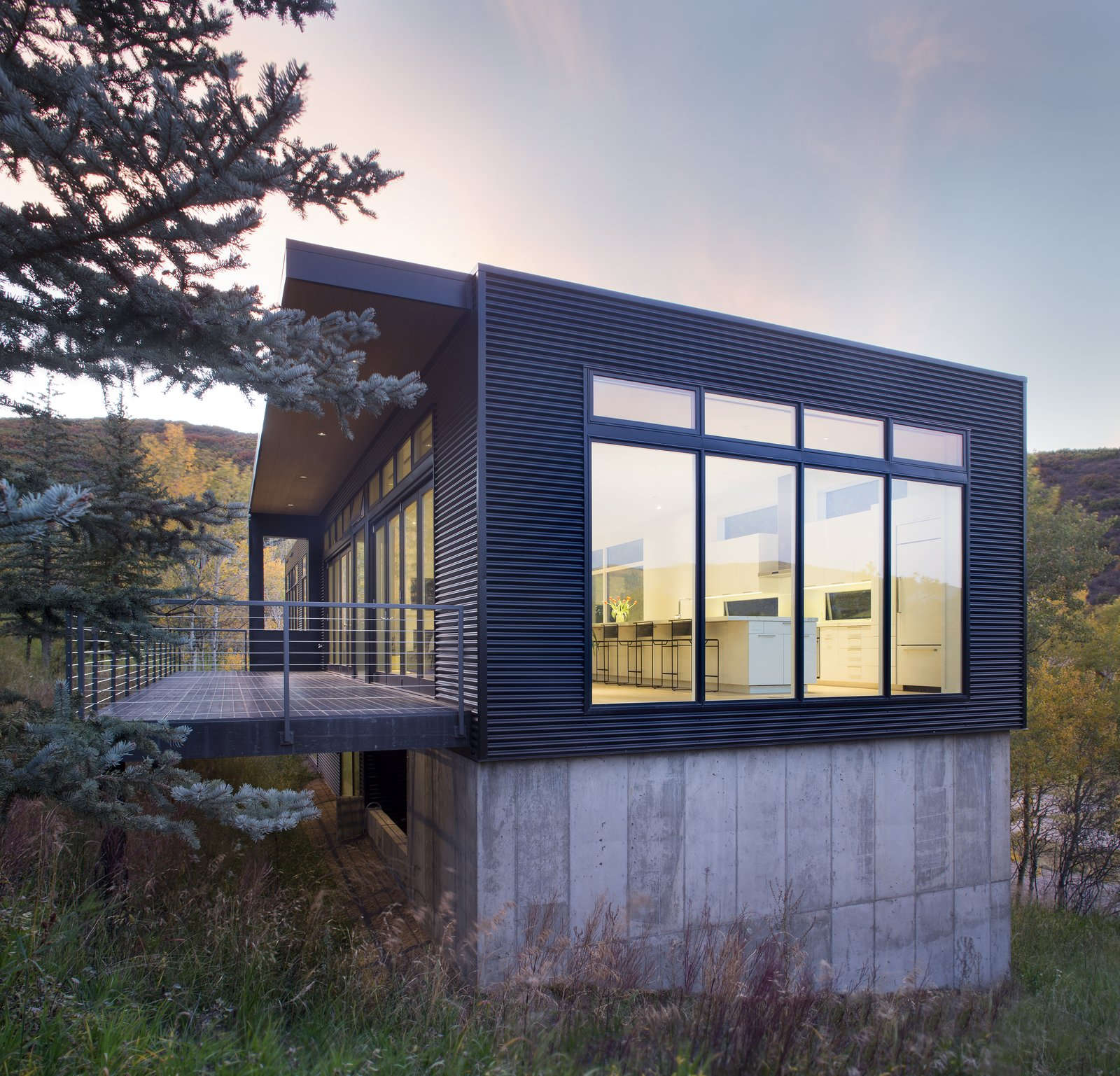 Tagged: Exterior, House, Flat RoofLine, Cabin Building Type, Metal Siding Material, and Concrete Siding Material.  Black Magic by rowland + broughton