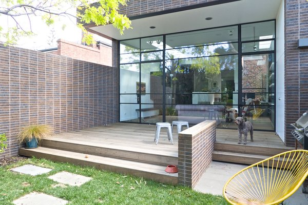 Modern home with outdoor, back yard, and grass. Courtyard Photo  of Residence K&S