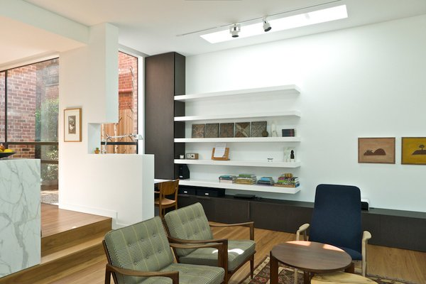 Modern home with living room, track lighting, and medium hardwood floor. Living Room & Study Nook Photo 3 of Residence K&S