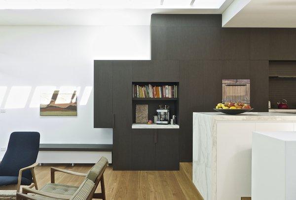 Modern home with kitchen, wood cabinet, ceramic tile backsplashe, marble counter, track lighting, and medium hardwood floor. Kitchen Photo 4 of Residence K&S