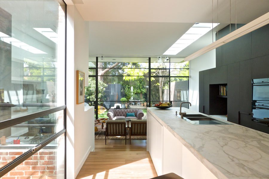 Kitchen & Internal Courtyard Tagged: Kitchen, Marble Counter, White Cabinet, Pendant Lighting, and Medium Hardwood Floor.  Best Photos from Residence K&S