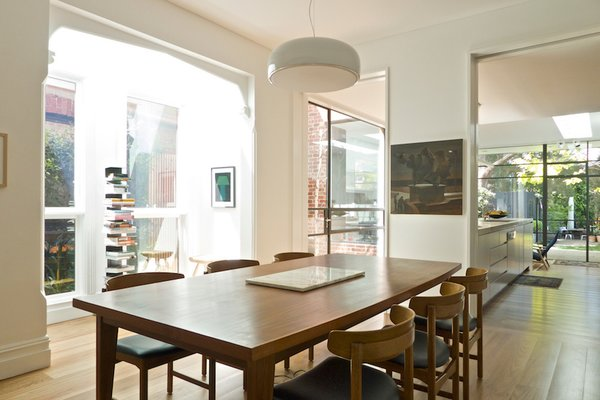 Modern home with dining room, table, medium hardwood floor, pendant lighting, and chair. Dining Room Photo 8 of Residence K&S