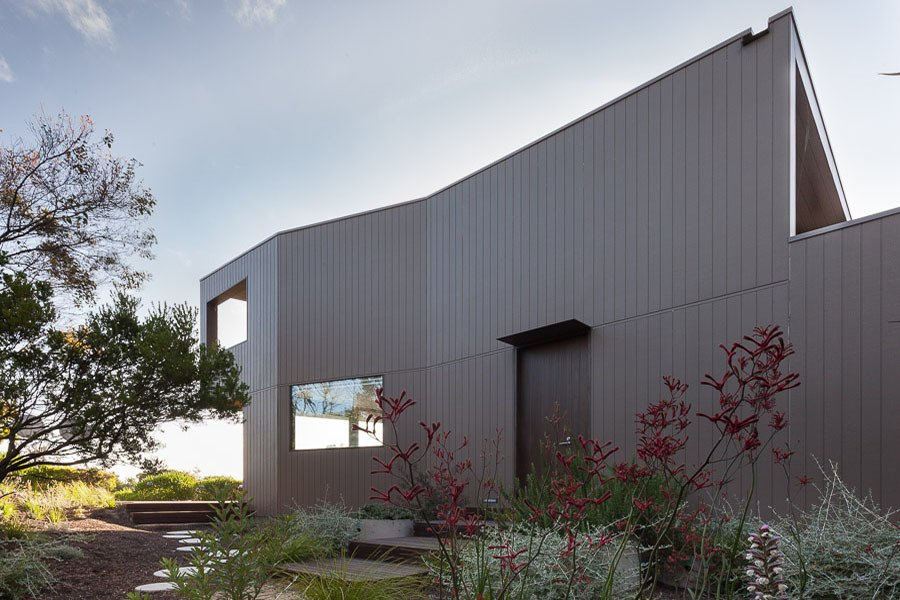 Side Facade Tagged: Outdoor, Side Yard, Trees, and Shrubs.  Residence J&C by Open Studio Pty Ltd Architecture