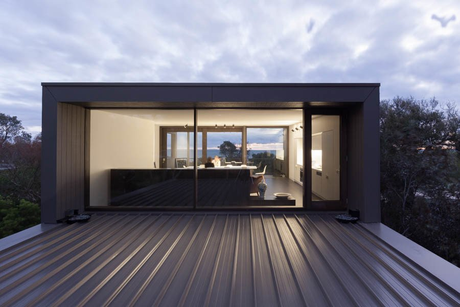 Living Room at Dusk Tagged: Windows, Wood, and Picture Window Type.  Residence J&C by Open Studio Pty Ltd Architecture