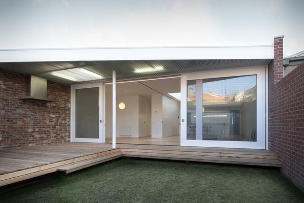Modern home with outdoor, grass, decking patio, porch, deck, and back yard. Courtyard Photo  of Residence L&N