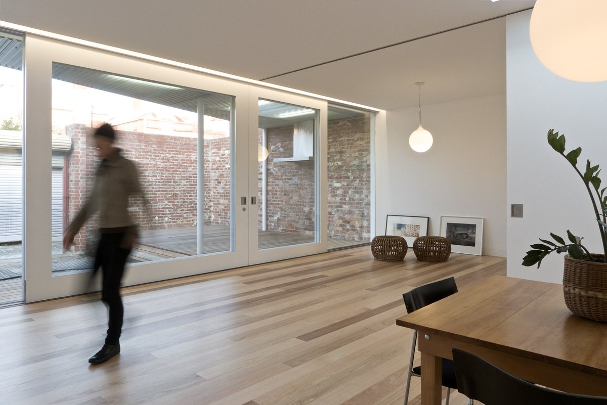 Living & Dining Tagged: Living Room, Pendant Lighting, and Medium Hardwood Floor.  Residence L&N by Open Studio Pty Ltd Architecture