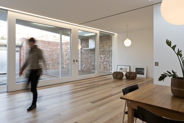 Modern home with living room, pendant lighting, and medium hardwood floor. Living & Dining Photo 3 of Residence L&N