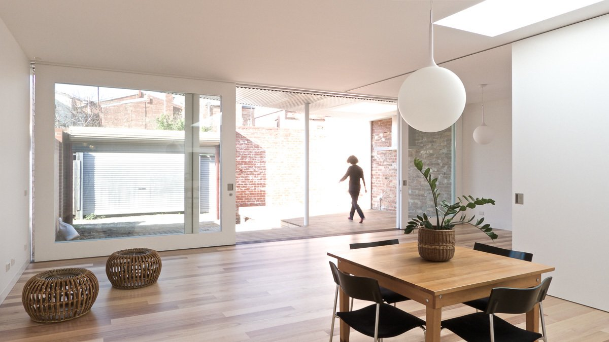 Glazed Sliding Doors Tagged: Living Room, Pendant Lighting, and Medium Hardwood Floor.  Residence L&N by Open Studio Pty Ltd Architecture