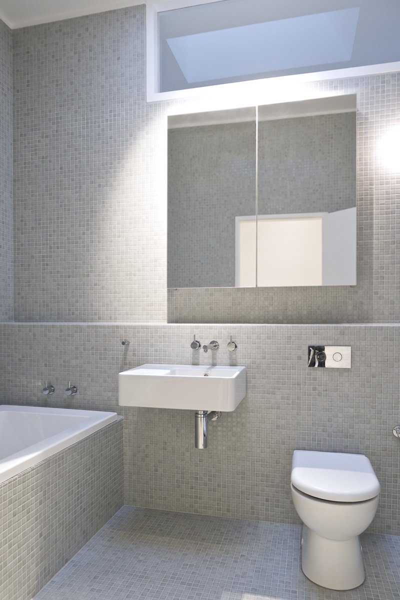 Bathroom Tagged: Bath Room, Tile Counter, Wall Mount Sink, Ceiling Lighting, Glass Tile Wall, Open Shower, Drop In Tub, and One Piece Toilet.  Residence L&N by Open Studio Pty Ltd Architecture