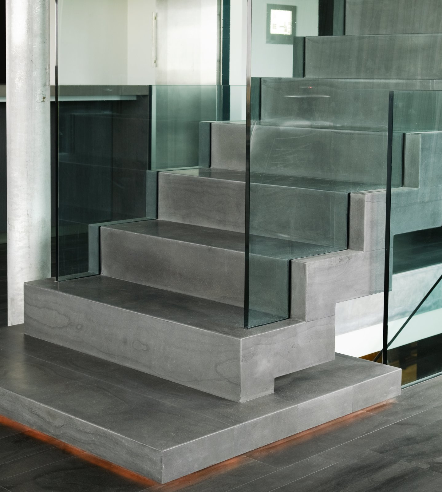 "staircase covered with the icelandic natural stone ""blagryti"" (bluestone)  Casa G by Gudmundur Jonsson Architect"
