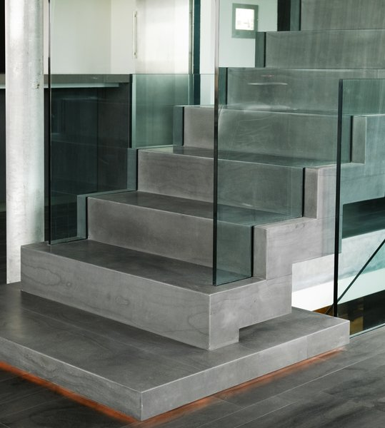 "staircase covered with the icelandic natural stone ""blagryti"" (bluestone) Photo 10 of Casa G modern home"