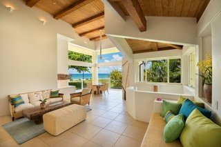 Hanalei Bay Villa – Contemporary Home on Hanalei Bay Offering Art & History - Photo 9 of 9 - Living room in Main House with 15 ft high ceilings and expansive ocean views