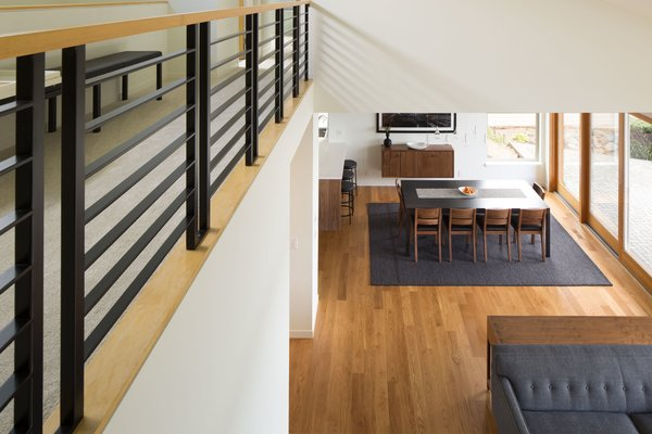 Looking down at the living room and dining room. Photo 3 of The Lakehouse modern home