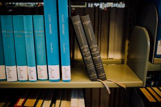 Sacred Space: an Exploration in Modern Bible Design - Photo 6 of 6 - Two Reader's Bible volumes rest at an angle on the shelf at the Mt. Angel Abbey Library.