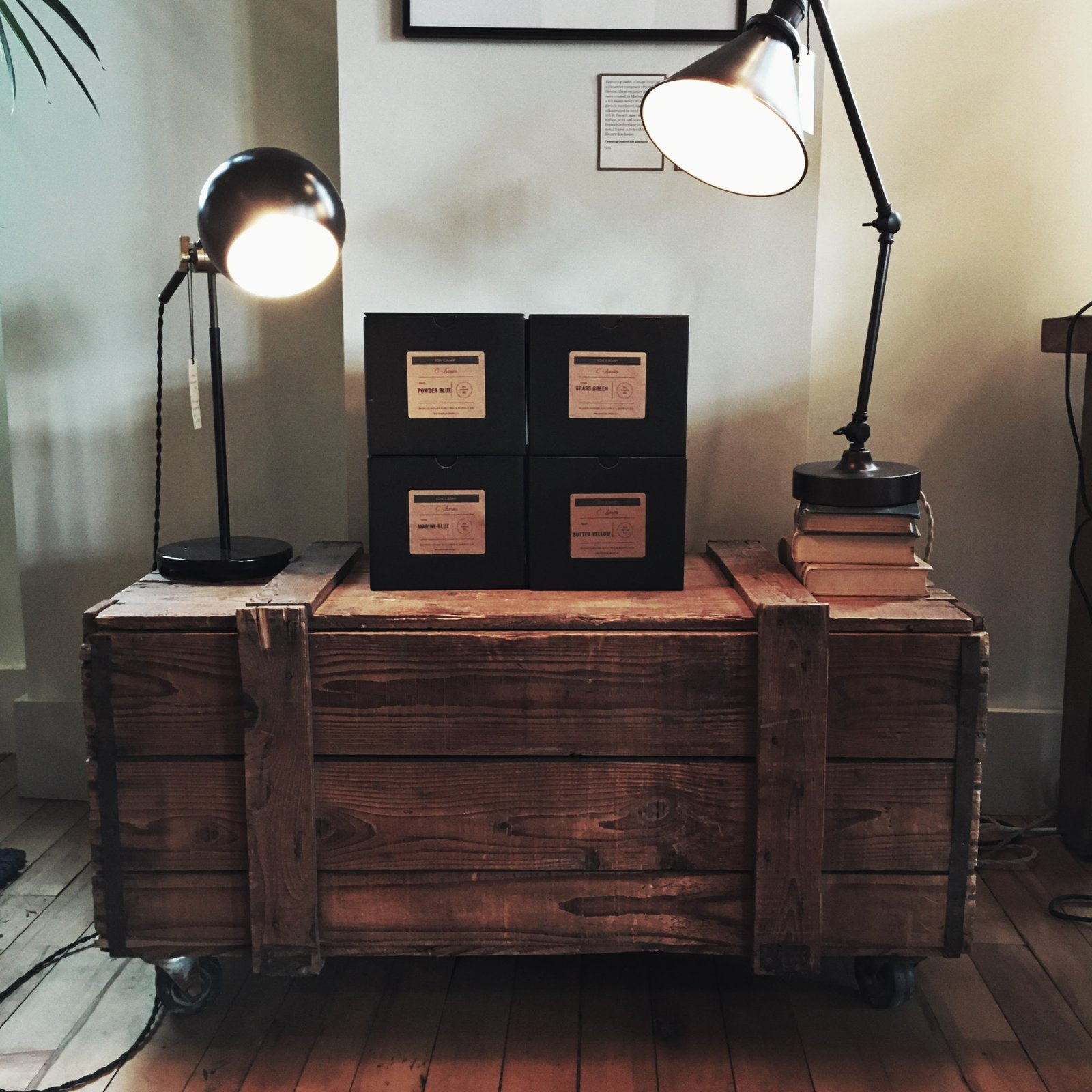 Lamps and an old create make for a stunning living room piece.