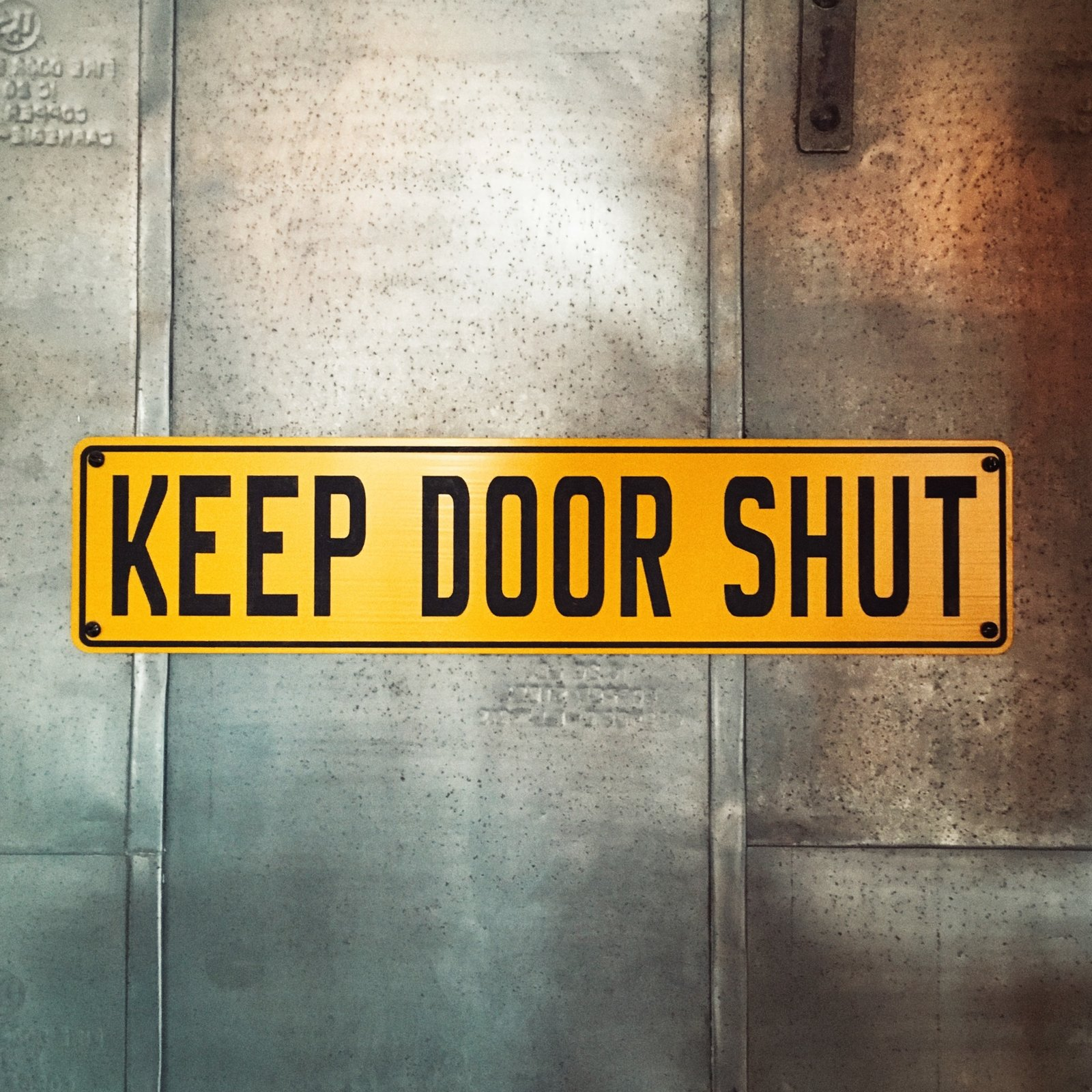 "The ""Keep Door Shut"" sign on a galvanized metal door resembles something you would expect to see in a nuclear bunker or on an episode of LOST.  Schoolhouse Electric by Jonathan Simcoe"