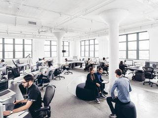 A Look Inside Squarespace NYC - Photo 3 of 10 - A work area is flooded with massive amounts of natural light.