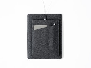 A minimal felt sleeve to hold an iPad Pro, notepad, and Apple Pencil.