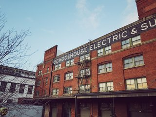 A Schoolhouse Electric Christmas - Photo 1 of 8 - An exterior view of Schoolhouse's factory and warehouse showroom space.
